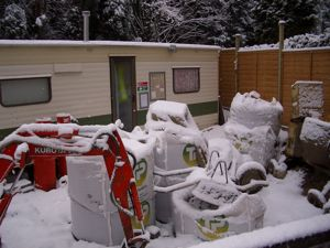 Static caravan on our self build site in the snow